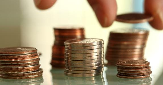 stacks-of-coins-grouped-together-hands-adding_573x300.jpg